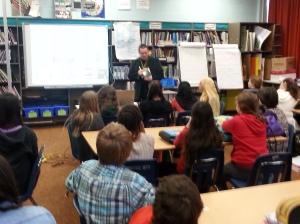 Some guy doing some presentation at Earl Grey Senior Public School.
